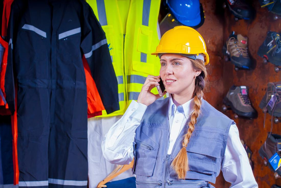 adult-braided-hair-cell-phone-worker